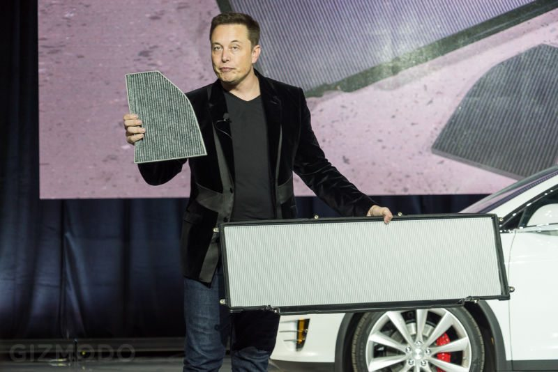 Elon Musk holding the large main filter and secondary filter Photo: gizmodo